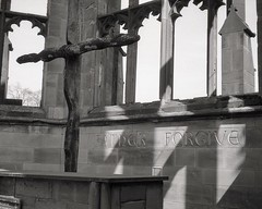 Coventry cathedral (OhDark30) Tags: olympus 35rc 35 rc 35mm film monochrome bw blackandwhite bwfp fomapan 200 rodinal coventry cathedral ruins altar cross window charredcross fatherforgive