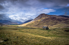 Waiting for the Light (daedmike) Tags: scotland glenshee bothy house ruin abandoned home mountain hills light ray clouds parting stream burn snow peaks summit derelict