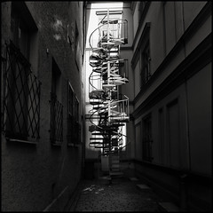 Escape! (Garry Corbett) Tags: fireescape escape ecmrecordscoverphotograph ecmrecordcoverphotographsgroup blackwhite lightshade shadowslight riga fujixpro1 latvia rigaboursemuseumofart nationalmuseumofartlatvia freedommonumentriga daugeva artnouveau architecture art