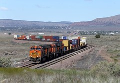 The Q-LACALT6-28 led by Dash9-44CW 4045 climbs out of the northern part of the Chino Valley as 2 other Eastbound trains wait in Seligman, Az (DTR CEO) Tags: stacks dash9 arizona seligman bnsf locomotive transcon