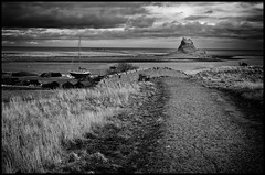 The End of the Road (Photoburglar) Tags: blackandwhite monochrome landscape lindisfarne nikon road clouds islands northengland holyisland