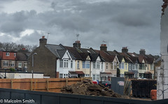 The Development (M C Smith) Tags: houses building rubble fence redevelopment pentax k3 sky blue grey clouds skip cars lamp aerials