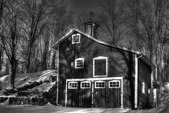 Woodbury Carriage House, Black & White (Skyelyte) Tags: woodburyct newengland rural country scenic snow cold winter blackandwhite monochrome trees stonewall fieldstone woods forest explore exploreapril22017 424 carriagehouse barn historicbarn hayloft cupola woodenbarn newenglandbarn weathervane
