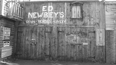 The Wild, Wild West 05 (byronv2) Tags: edinburgh edimbourg scotland morningside architecture building oldwest wildwest cowboys history quirky odd folly eccentric michaelfaulkner sign faded livery stable wood wooden doors elpaso blackandwhite blackwhite bw monochrome
