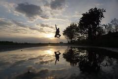 From sky to sky (pattaoverhage) Tags: düsseldorf niederrhein mirror jump sprung sunset wolken clouds germany sky nature freedom air rhein oberkassel outdoor shooting wasser water sony alpha alpha5100 nice sun sonne shine scheinen spring frühling landscape doppelt herrlich winner pose