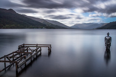 Standing strong through the storm (Marc Böhning) Tags: mirror man loch earn four seasons hotel scotland lake clouds jetty bay storm lee filters nd grad standing strong