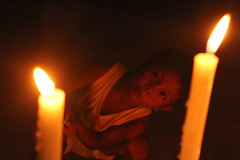 Twisted look and glow (Bruce Estilo) Tags: candles night evening warm philippines journalism lowlight canon line perspective