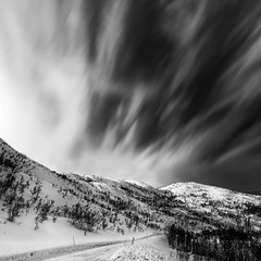 Wild Winds Are Blowin' (Nigel Jones Ex-LRPS) Tags: norway arcticcircle winter snow mountains clouds blowing wind cold photoshop nikefex silverefex