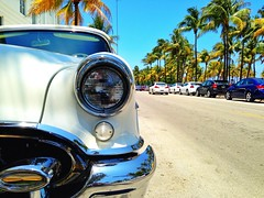 Miami Beach Oldsmobile (Marcelo Taube) Tags: ocean old blue sky sun tree beach beautiful car vintage drive day florida coconut miami sunny clear vacations regionwide
