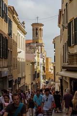 Crowded street (Jim Mead) Tags: street people church spain bell crowd belltower busy santamaria menorca minorca iglesiadesantamaria menorquin