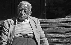 Enjoying the sunshine (Wilamoyo) Tags: street york old summer portrait bw white black men sunshine bench jacket elderly seated gentleman