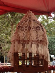 A very beautiful mosquito net covers the cradle (bw.ruth) Tags: carpet market silk hotan cradle