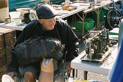 Remembering (Andrew D2010) Tags: old man film broken bike bag junk wheelchair leg objects australia victoria camberwell nikonfm3a fujicolorpro400h camberwellmarket nikon50mmf18ai