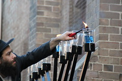 Rabbi lights oil's wick (bobmendo) Tags: beard chanukah synagogue oil newtown wick hanukkah menorah hanukkiah