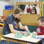 A student teaching a preschooler