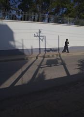 Outside the British Embassy, Kathmandu (Salle-Ann) Tags: man wall walking shadows head over wires