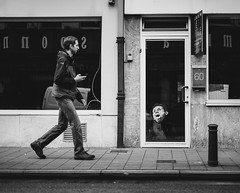 60 (Ash and Debris) Tags: bnw face street gent walking emotion door sticker bw urban monochrome belgium contrast blackandwhite streetlife wall europe city walk