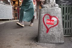 Fragile (splorp) Tags: market paint spraypaint heart sticker type typography person legs walking sidewalk metal concrete cement pikeplace seattle washington usa