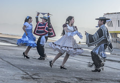 More Cueca Dockside Coquimbo (Tom Kilroy) Tags: coquimbo chile people celebration dancing groupofpeople outdoors graduation cultures dress men traditionalclothing event parade hat fun adult day
