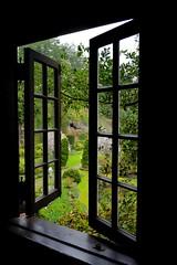 Window on Spring (Dee Woodhead) Tags: butchartgarden victoria bc fujifilm xt1 deewoodhead green black garden trees shrubs people umbrellas canada snapseed