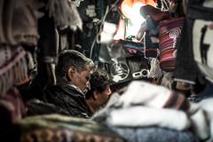 Seller in Cusco's Market (matiasrquiroga) Tags: cusco peru travel viaje light shadows frame framing fabric old seller market vendedor mercado viejo tela ngc