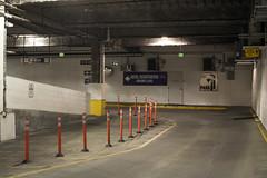 Parking Garage (Curtis Gregory Perry) Tags: boise idaho parking garage hampton inn hotel registration sign pylon cone exit pedestrian caution area night longexposure nikon d810