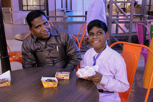 KidZania Tour for Kids with disabilities: One of the children from the group can be seen here with his father.
