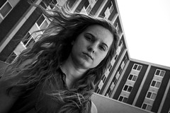 She and the building. (Reza Mehr) Tags: architecture athens building day exterior girl marnie openshade people portrait summer usa us grain colorgrading blackandwhite bw athensohio backlighting