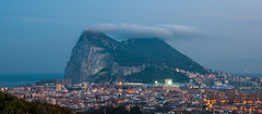 Under a Cloud (Oliver J Davis Photography (ollygringo)) Tags: gibraltar rock city cityscape europe la línea de concepción spain cadiz andalusia andalucia sillón reina queens chair sierra carbonera dusk evening night lights promontory pillar hercules sea mediterranean coast africa nikon d90 urban urbanised ocean village marina sunborn rif mountain range ridge san roque world trade center landscape cloud levante levant weather brexit future morocco gloomy