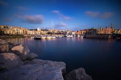 E poi esiste la città che respira... (Salvatore Brontolone) Tags: port porto pozzuoli mare sea scogli barche boat cielo sly nuvole cloud reflective riflessi azzurro bleu case borgo house