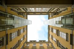 Surrounded (CoolMcFlash) Tags: inner courtyard architecture modern facade vienna lowangleview perspective geometry geometrie window building austria fujifilm xt2 sky innenhof architektur fassade wien perspektive blickwinkel fenster gebäude österreich fotografie photography urban city pattern muster