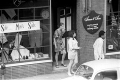 h3-68 10 (ndpa / s. lundeen, archivist) Tags: nick dewolf nickdewolf bw blackwhite photographbynickdewolf film monochrome blackandwhite city summer 1968 1960s 35mm boston massachusetts candid streetphotography citylife streetlife people youngpeople beaconhill charlesstreet sidewalk pedestrians store shop business window windows storewindow simonsons clothingstore street car vehicle automobile parkedcar door entrance parkingmeter woman women youngwoman youngwomen man youngman black africanamerican sandals dress sign signs sale menssuits tailor tailors cleansers