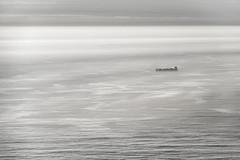 Barco en niebla (Carlos_Silva1) Tags: aguarda atlanticsea atlantico baixomiño barco boat buque carguero cincocomaseis clouds fog galicia laguardia mar monte niebla nikon nubes ocaso reflects reflejos santatecla santatrega sea sol sun sunset españa es