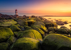 Evening Light (andreassofus) Tags: landscape grandlandscape nature beach sea seascape seaside rocks lighthouse sunset sky clouds water ocean light summer summertime greenrocks