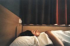 Sleep or not. (Erwan Bela) Tags: lomo lca ms1001000800 xpro e6c41 35mm expired périmée 135 woman femme lit bed