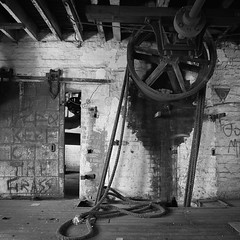 Main driveshaft at Harts Mill. (mernamora) Tags: derelict hartsmill flour mill analogue bw monochrome old antique machines machinery discover patent