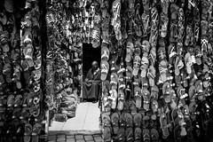 The slipper Bazar (superUbO) Tags: marrakech marocco slipper bazar shop frame monocrome leica man suk muslim uboldiemanuele wwwphotoworksit streetphotography street trip