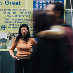 In China Town, London (Etienne Gaboreau) Tags: china town chinatown falun gong falungong mediatation london londoner londoners uk united kingdom long exposure chine woman street streetphotography