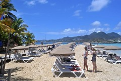 View from the Karibuni (AntyDiluvian) Tags: beach umbrella island restaurant saintmartin lounge lisa stmartin tropical meredith caribbean lounger sxm sintmaarten pinelisland orientbeach chaiselounge frenchwestindies orientbay fwi frenchside iletpinel karibuni