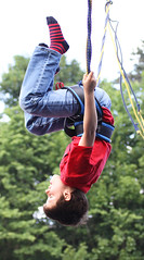 Hanging out (Wilamoyo) Tags: boy red tree male socks shirt kids t fun child play action bokeh stripes down trampoline jeans hanging activity bounce upside definite