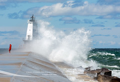 Stormy Waters at Ludington Lighthouse (Craig - S) Tags: light usa lighthouse storm midwest waves michigan windy lakemichigan winds breaking ludington crashingwaves splashing masoncounty ludingtonmichigan northbreakwater craigsterken