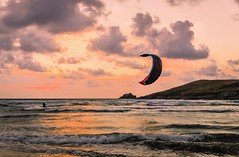 Lone kite surfer at dusk (Jez22) Tags: ocean sunset sea summer england sky copyright sun kite man beach sports nature wet water silhouette sport speed fun outdoors person evening coast athletic jump freestyle cornwall surf waves wind action dusk surfer board extreme scenic wave surfing kitesurfing atlantic lone leisure recreation trick kiteboard activity splash kitesurf adrenaline boarding active cornish crantock jeremysage