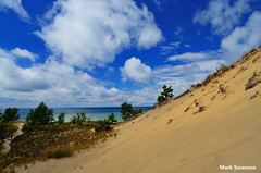 Grand Mere Dunes - Explore (mswan777) Tags: travel sky lake color beach nature grass clouds landscape sand nikon waves michigan dunes lakemichigan greatlakes polarizer circular d5100