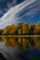 Parc Lafontaine in fall (Scott Robertson, Montreal) Tags: park autumn trees red orange lake canada colour reflection fall halloween water beautiful vegetables leaves yellow season spectacular pond october cyclist forsale market quebec sale pavement farm montreal pumpkins fine sunny stall bluesky supermarket falling sidewalk crisp changing pedestrians serene farmer organic footpath parclafontaine banks grocer mild gold