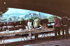 Book buying under the bridge (IanAWood) Tags: london streetphotography southbank 35mmfilm contaxg2 secondhandbookshop kodakportra160 londonstreetphotography notwalkingwithmynikon carlzeissplannart245forcontaxg