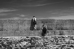"""""""We have different views on life..."""" (Fly bye!) Tags: summer people sunglasses wall clouds women rocks cornwall harbour tourists stives harbourwall stopne"""