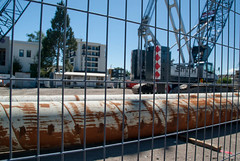 To Go Down Many Metres (Jocey K) Tags: trees newzealand christchurch sky building architecture construction rust shadows pipe cranes vehicles cbd buildingsite rebuild