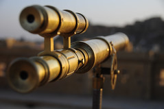 With a telescope I can see Uranus (Saumil U. Shah) Tags: old travel sculpture india art heritage history tourism town sandstone view desert fort antique indian culture craft tourist historic telescope aim brass fortress jaisalmer rajasthan spyglass select shah goldencity भारत saumil राजस्थान incredibleindia जैसलमेर saumilshah अतुल्यभारत
