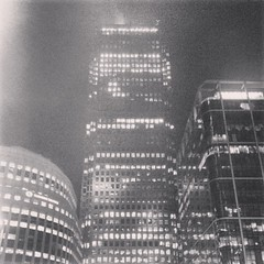 Light Mist (Zepsis) Tags: city uk blackandwhite bw mist reflection london tower glass mobile night buildings lights mono office haze cellphone filter noise canarywharf android onecanadasquare thomsonreuters instagram flickrandroidapp:filter=none samsunggalaxys4