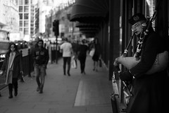 Bagpipe (MikeKlauza) Tags: red london street photography bw bagpipe irish